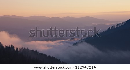 Foggy mountain valley sunrise. Great Smoky Mountain National Park, Tennessee, USA - stock photo