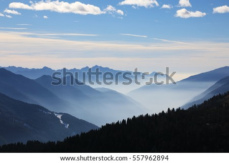Foggy mountains in winter, Dolomite Alps in Madonna di Campiglio (Five Lakes place). Italy
