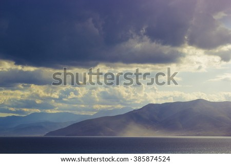 Foggy mountains seascape - stock photo