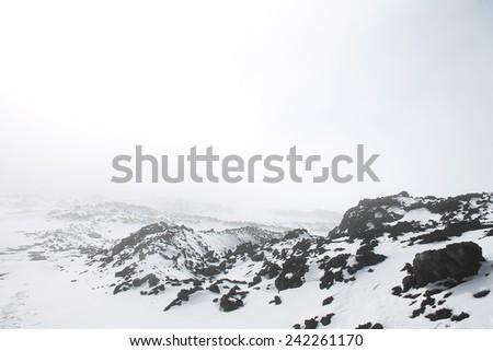 foggy mystery landscape of place near volcano  - stock photo