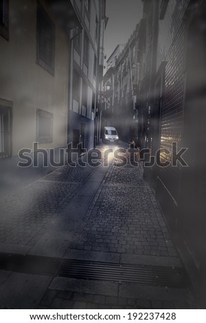Foggy narrow street at dawn, Porto, Portugal - stock photo