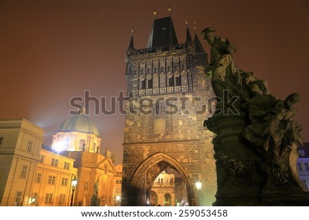 Foggy night cover the Gothic tower and statues on Charles bridge, Prague, Czech Republic - stock photo