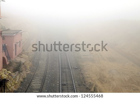 Foggy railway track. - stock photo