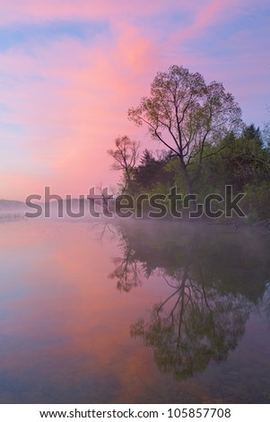 Foggy, spring shoreline of Whitford Lake at dawn, Fort Custer State Park, Michigan, USA - stock photo