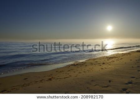 Foggy Sunrise Over Ocean - stock photo