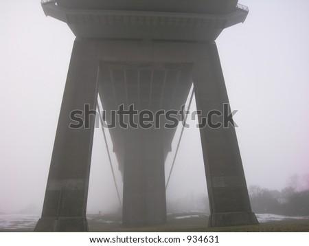 Foggy Suspension Bridge - stock photo