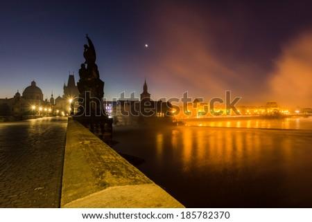 Foggy twilight on a Charles bridge in Prague  - stock photo