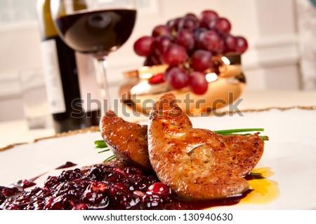 Foie gras with berries - stock photo