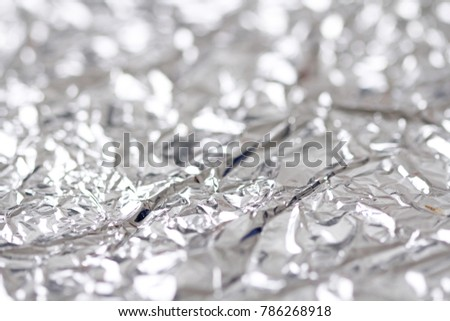 Foil. Metal crumpled background. Gray or silver background.