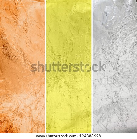 Foil paper surface in bronze, silver and gold style - stock photo