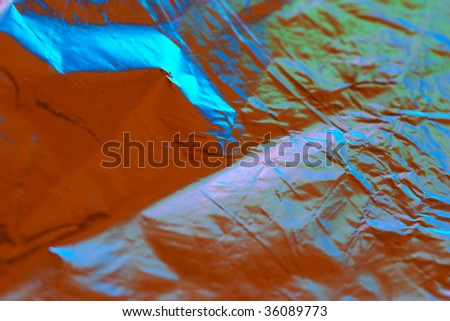 Foil with color reflection partially blurred background