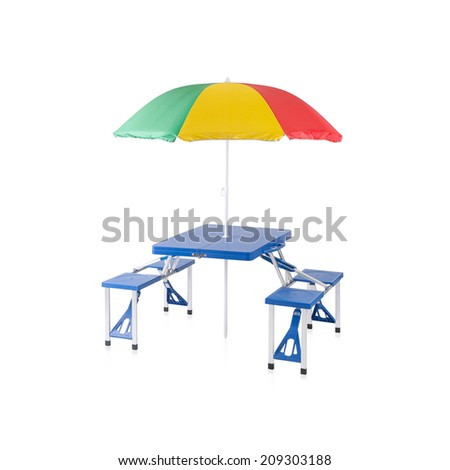 Fold able and portable picnic table with sunshade isolated on white - stock photo