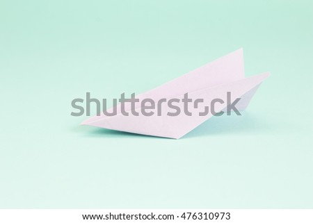 Fold rocket paper on green background.