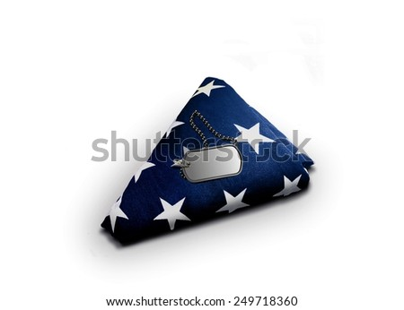 Folded American Flag with Military Dog-tag - stock photo