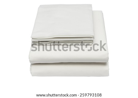 Folded bed linen or duvet cover on white isolated background - stock photo