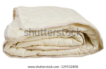 Folded beige blanket, isolated on white. - stock photo