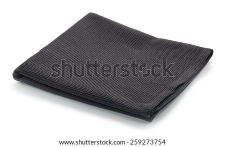 Folded black cotton napkin isolated on white background - stock photo