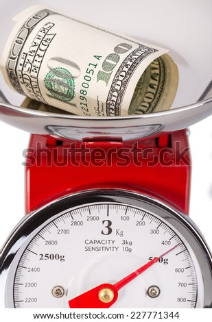 Folded dollar on scales. Currency dollar. - stock photo