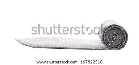 Folded gray tie with white speck. Isolated on a white background. - stock photo