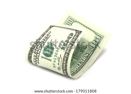 folded hundred dollar bills on a white background - stock photo