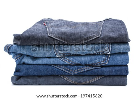 folded jean stack on white background - stock photo