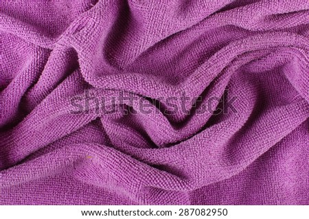 Folded microfiber cleaning cloth abstract surface pattern - stock photo