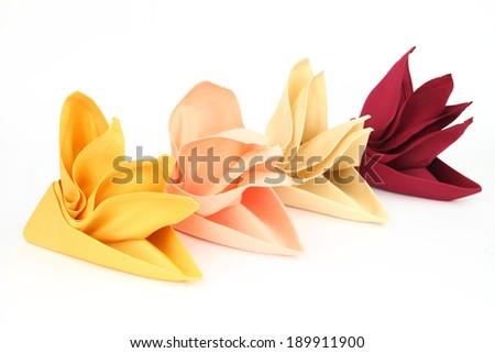 Folded napkins on the white background - stock photo