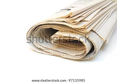 Folded newspaper on white background - stock photo