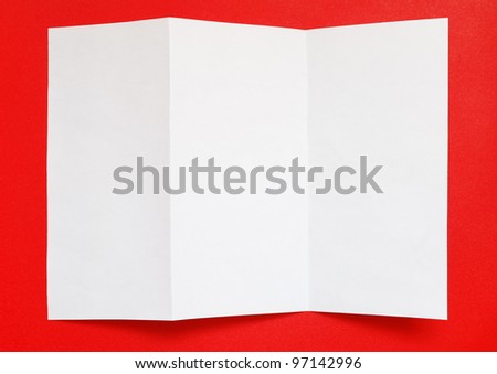 Folded paper on red background, top view - stock photo