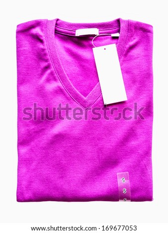 Folded purple t-shirt with price tag isolated on white