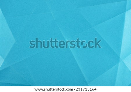 Folded sheet of blue paper background - stock photo
