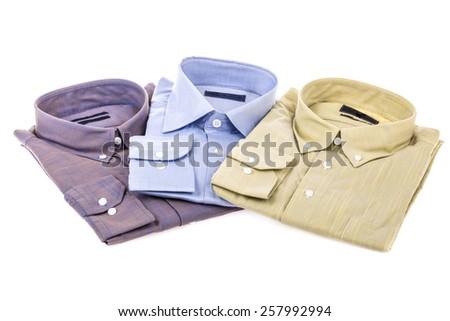 folded shirts on white - stock photo