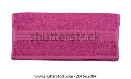 Folded terry towel isolated over the white background - stock photo