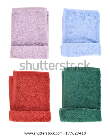 Folded terry towel isolated over the white background, set of four color versions - stock photo