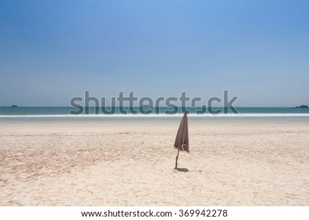 Folded umbrella on beach