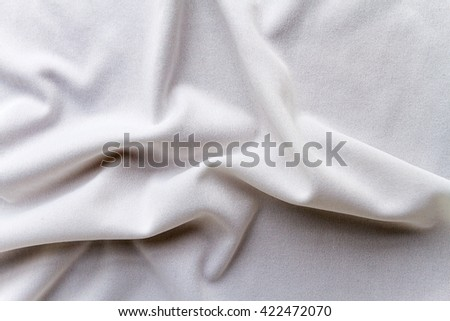 Folded white cotton fabric with texture  - stock photo