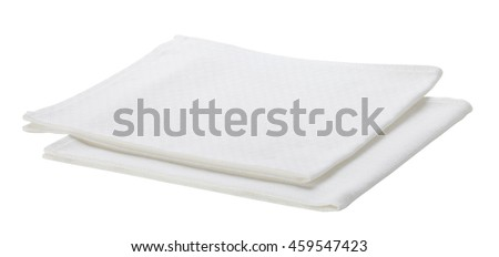 Folded white cotton napkin isolated on white background. Include clipping path.