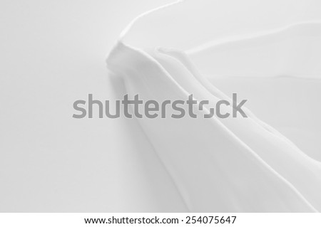 folded white damask table napkin, image from above