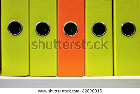 Folder and Folder  Stationery orange folder - stock photo