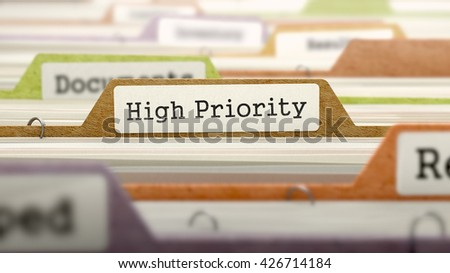 Folder in Colored Catalog Marked as High Priority Closeup View. Selective Focus. 3D Render. - stock photo