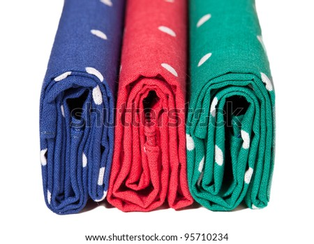 Folder linen handkerchiefs in red blue and green with white spots