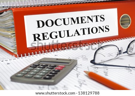 folder marked with documents and regulations - stock photo