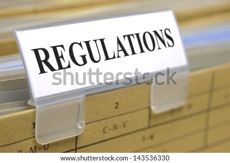 folder marked with regulations - stock photo