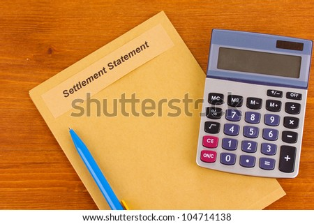 folder with information on real estate on wooden background close-up