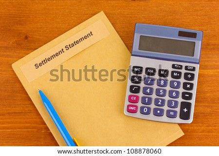 folder with information on real estate on wooden background close-up - stock photo