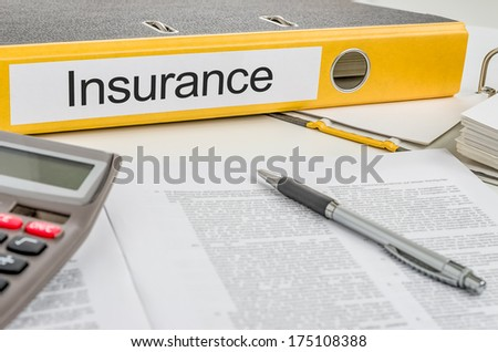 Folder with the label Insurance - stock photo