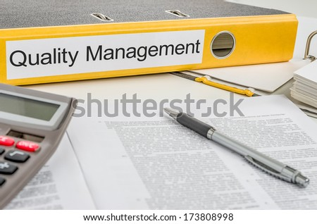 Folder with the label Quality Management - stock photo
