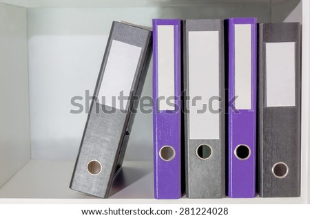 Folders for documents on a book shelf - stock photo