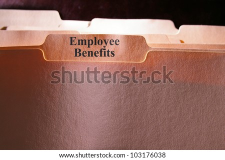 folders with Employee Benefits text - stock photo