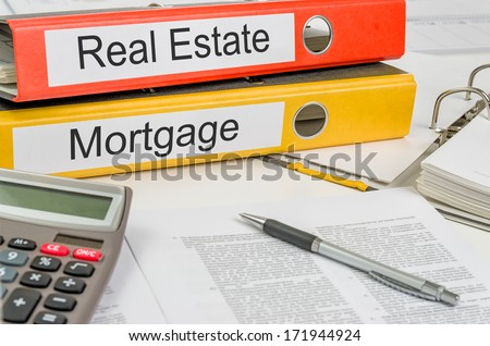 Folders with the label Real Estate and Mortgage - stock photo